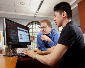 Eric Luhrs, center, head of digital scholarship services, has helped the library develop the infrastructure it needs to support research in the digital humanities. Here he works with Miguel Haruki Yamaguchi '11 on MetaDB, a software program that Luhrs created to allow scholars and librarians to collaborate on the creation of metadata.