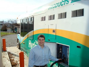 Mathew Pezon '10 refuels Air Products' H2 bus, which is used on the company's Allentown campus.
