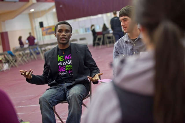 Chrispin Otondi '13 speaks with other students.