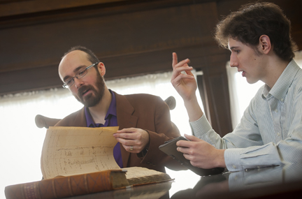 Lafayette College professor Chris Phillips (left) and Gavin Jones '14 examine early circulation records at Easton Public Library.