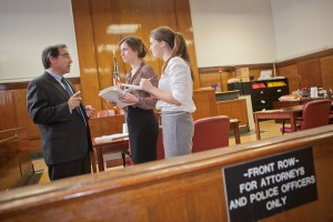 Daniel Rosen P'12 speaks with Megan Devlin '12 and Elizabeth Moroney '14 at the New York Supreme Court.