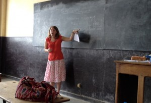 Erin D'Amelio '13 stands in front of a chalkboard in a classroom in Madagascar.