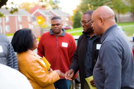 Prof. Wendy Wilson-Fall (left) talks with attendees including Lawrence Lemon '71 (far right)