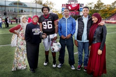 Defensive lineman Tahir Basil '13 poses with his family.
