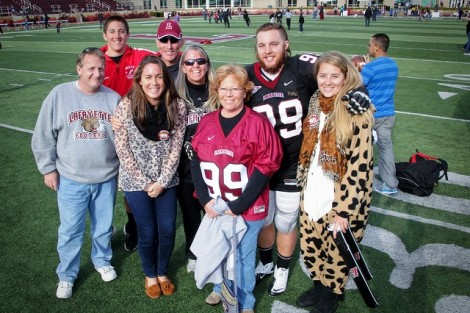 Defensive lineman Rick Lyster '13 poses with his family.