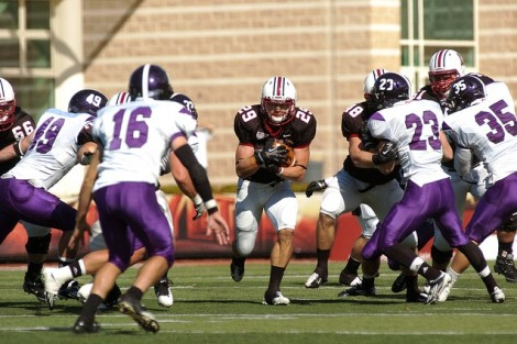 Tailback Ross Scheuerman '15 finds a hole in the Holy Cross defense.