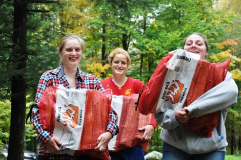 Andrea Mikol '13, l-r, Abigail Mitchell '13, and Hannah Griesbach '13 haul firewood.