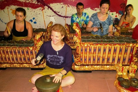 Katie Zeikel '15, l-r, Professor Jennifer Kelly, Derek Vill '14, Professor Mary Jo Lodge, and Savannah Sargent '13 try out their musical  skills in a gamelan ensemble during an interim course focusing on the arts in Bali.