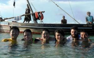 Yen Joe Tan '14 and classmates stand in water up to their necks off the coast of the island of Zanzibar in Tanzania