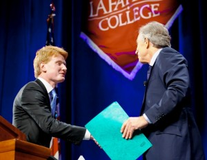 Student Government president Michael Prisco '14, left, introduces Tony Blair.