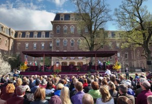 President Jimmy Carter delivers a lecture on the Quad with Pardee Hall in the background.