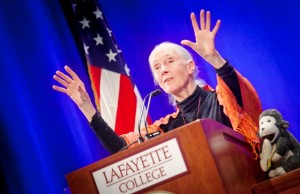 Hands raised for emphasis, Jane Goodall speaks at a podium in Lafayette's Kamine Gym.