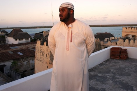 Dressed in a white kanzu, Tahir Basil '13 overlooks Lamu town before attending evening prayers in one of Lamu's many mosques.