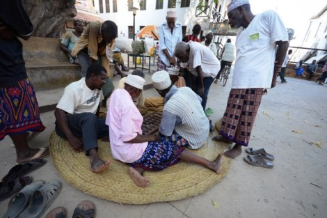 Swahili men play mbao, a board game which is widely played across the continent.