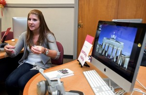 Nicole Dieterich '13 sits and discusses her experiences in Germany by a desk with a computer