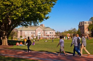 Students walk along a pathway on the newly-renovated Quad.