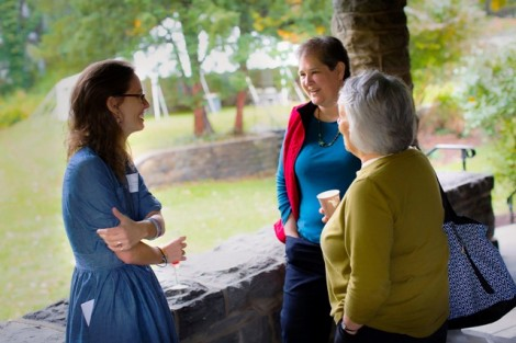 Caroline Lee, left, assistant professor of anthropology and sociology and McKelvy faculty adviser, speaks with Laura May '72 on the building's porch.