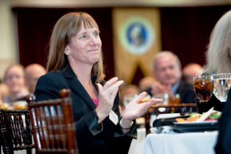 President Alison Byerly laughs at a joke during the inaugural luncheon.