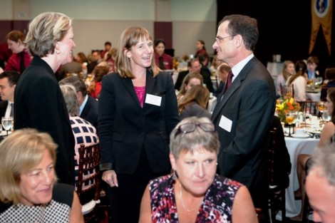 President Byerly speaks with former President Dan Weiss and Sandra Jarva Weiss.