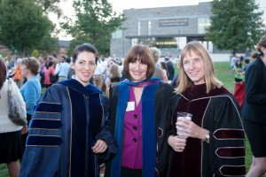 President Alison Byerly poses with Emily Musil Church, left, assistant professor of history, and Caryn McTighe Musil at the President's Reception following the convocation ceremony on the Quad.