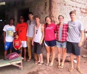 The students relax with some of the villagers.
