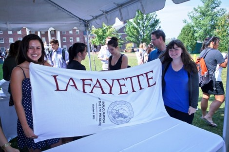 Students pick up their commemorative inauguration beach towel during the dessert social in Anderson Courtyard.