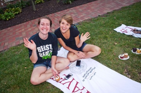 Students put their commemorative inauguration beach towel to good use during the dessert social in Anderson Courtyard.