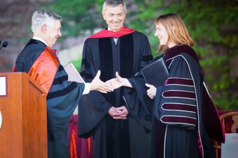 Edward Ahart '69, left, chair of the Board of Trustees, and Stephen Pryor '71, vice chair of the board, congratulate President Alison Byerly.