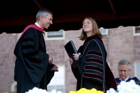 Stephen Pryor '71, vice chair of the board, presents President Alison Byerly with a copy of The Charter and Statues of the College as a symbol of her presidential authority.