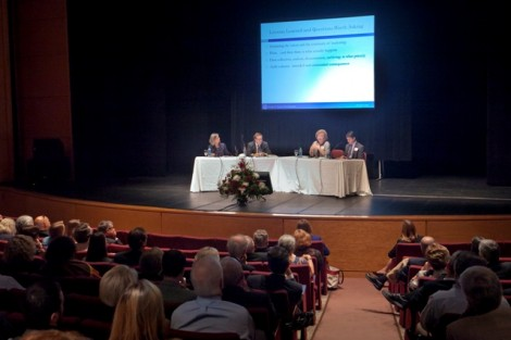 The panel discusses 'New Models for Higher Education.'