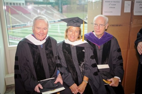 Charles Hugel '51, former chair of the board, Trustee Barbara Levy '77, and Alan Griffith '64, former chair of the board, relax during the robing ceremony.