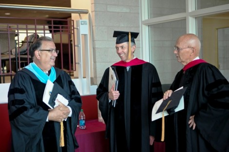 Easton Mayor Sal Panto, l-r, Stephen Pryor '71, vice chair of the board, and David Reif '68, president of the Alumni Association, mingle during the robing in Kirby Sports Center.