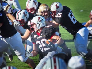 Tailback Ross Scheuerman '15 carries the ball during last year's game.