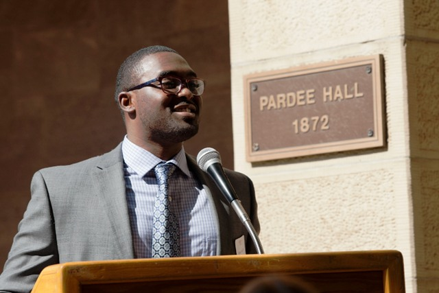 Robert Young '14 speaks at the exhibit opening reception.