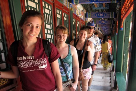 Students pose in a traditional corridor in the Summer Palace in Beijing, China.