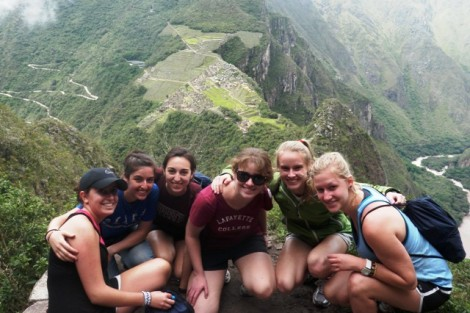 Students rest on a mountain overlooking Machu Picchu, Peru.