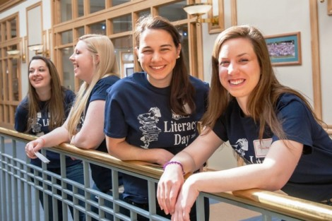 Meg Del Col '15, left, and Rachel Leister '15 wait to be paired with children.
