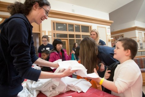 Alyson Linsenberg '15 hands out Literacy Day T-shirts.