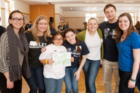 Members of LEAP, from left, Sadie Lebow '17, Shannon Hurley '17, Grace Todesco '17, Caroline Ladlow '16, Michael Rockman '15, and Michelle Jennings '17 pose with a student.
