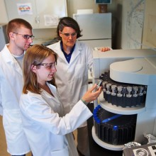 Chris Kelly '13, Hollis Miller '14, and Professor Kira Lawrence work in the lab.