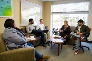 Deja Washington '14, Brandon Turner '14, Alec Golini '14, professor Deborah Byrd, and Fredy Flores '14 discuss their work with the Easton Area Neighborhood Center.