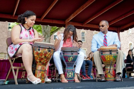 Jenny Mena '14, from left, Shanequa Lassiter '14, and Abenezer Solomon '14 perform 'Tongues and Hands Untied,' a spoken word and percussion piece.