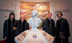 Jamaican Prime Minister Portia Simpson Miller, l-r, Harry Ettlinger, Kevin Mandia '92, and Roger Ross Williams, stand by the bust of the Marquis de Lafayette in Markle Hall.