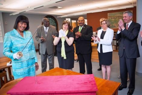 Jamaican Prime Minister Portia Simpson Miller handles the sword of Marquis de Lafayette.