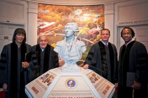Honorary degree recipients Jamaican Prime Minister Portia Simpson Miller (L-R), Harry Ettlinger, Kevin Mandia '92, and Roger Ross Williams stand by the bust of the Marquis de Lafayette in Markle Hall.