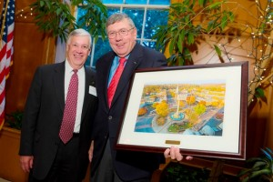 Edward Ahart '69, left, chair of the Board of Trustees, presents a painting to trustee Carl Anderson '67 for serving as chair of the Easton Committee since 2003.
