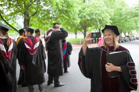 President Alison Byerly takes some images for Twitter of the academic procession.