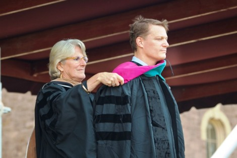 Nancy Kuenstner '75, secretary of the Board of Trustees, presents Kevin Mandia '92 with the hood emblematic of his honorary Doctor of Public Service degree.