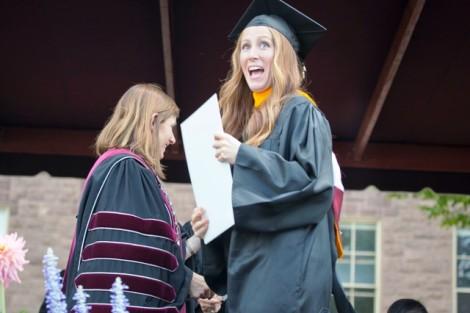 Students receive their diplomas.
