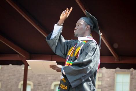 Students celebrate receiving their diplomas.